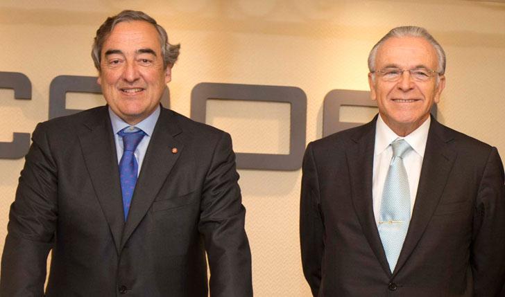 Representantes de Caixabank y CEOE.