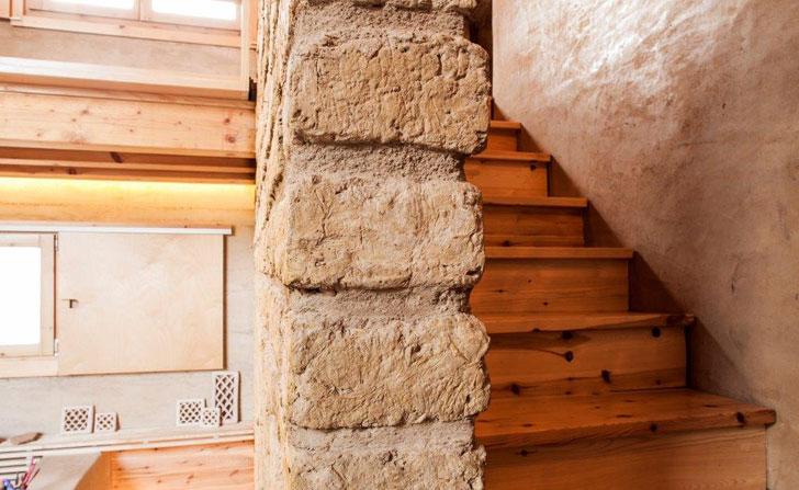 Muros de piedra de la vivienda sostenible en 3 alturas.