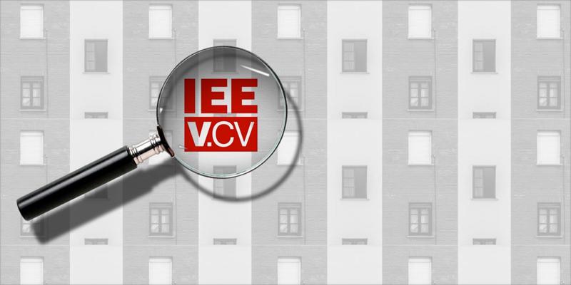 imagen de edificio y lupa IEEV.CV