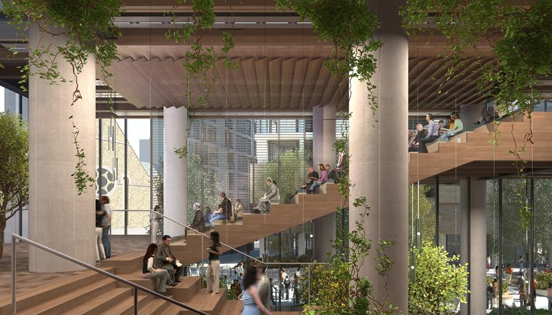 La escalera gran principal de madera es una de las particularidades de este nuevo edificio de oficinas.
